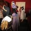 Visitors examining costumes