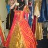 Julia designing an Orange Masquerade Gown